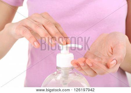 Woman using liquid soap, closeup
