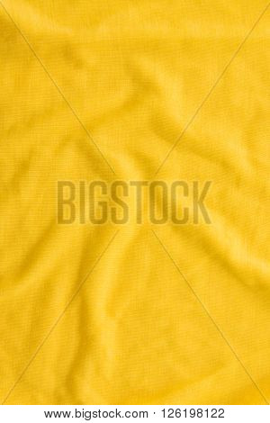 Close up of beautiful wrinkle yellow fabric texture.