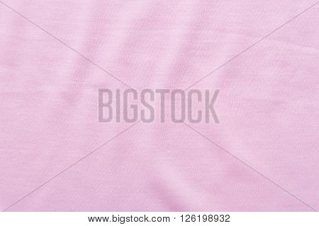 Close up of beautiful wrinkle pink fabric texture.
