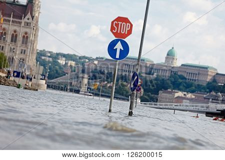 Flooded street n Budapest with traffic sign
