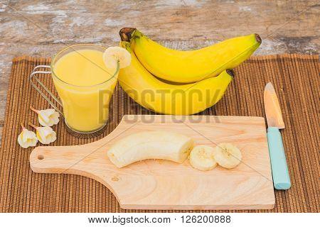 bananas and a sliced banana and banana smoothies.