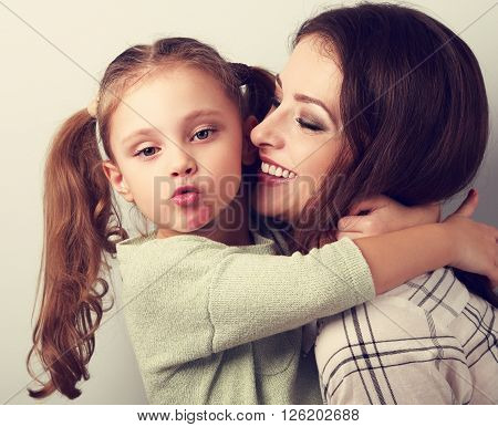 Fun Bully Kid Girl Showing Kiss Sign With Mother Lipstick Kiss Mark On Chin And Hugging Her Laughing