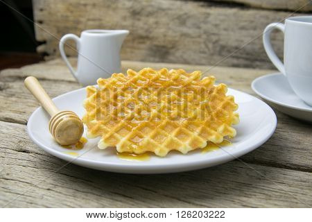 waffle with a cup of Coffee and honey