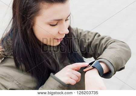 Young Brunette Girl Using Her Smart Watch