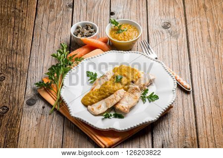 chicken fillet with carrot and capers cream sauce