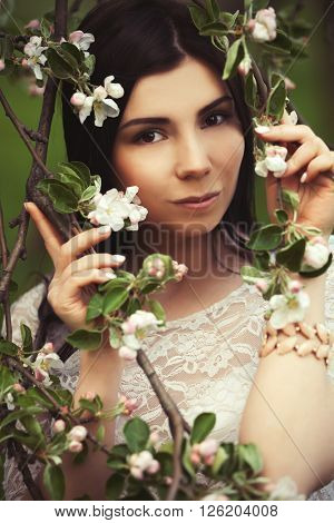 Young Attractive Girl Loves Lilic Flower Garden