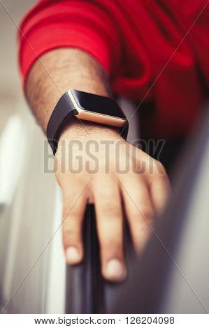Hand Of Black Man Wearing Smart Watch Sitting In Car