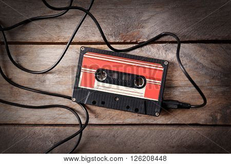 Retro cassette on wooden table, closeup