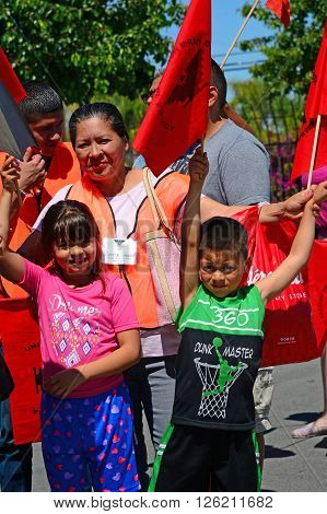 DELANO, CA - APRIL 17, 2016: Two young children are enjoying their participation in today's march by the members of the United Farm Workers for agricultural workers' rights.