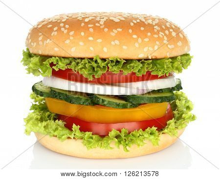 Healthy vegan burger with raw vegetables on white background