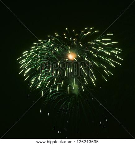 Green colorful fireworks in black background,artistic fireworks in Malta,Malta fireworks festival in dark background