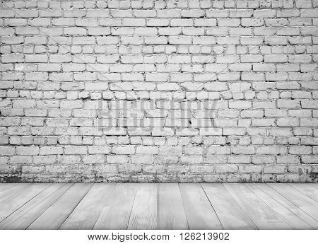 Interior with white brick wall and white wooden painted floor for background.