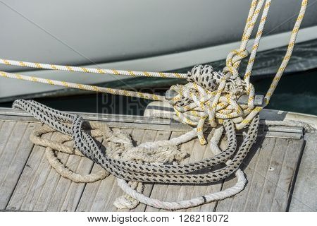 Tangled mooring ropes on the pier of Los Gigantes. Tenerife. Spain