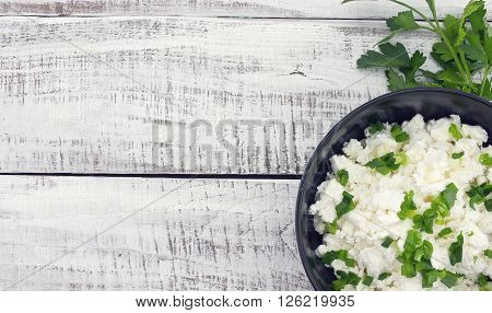 Cottage Cheese With Chives In Black Ceramic Bowl On Rustic Wooden Background. Healthy Breakfast. Hea