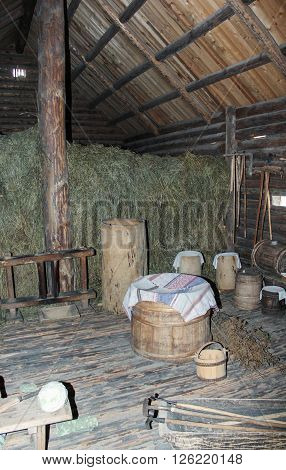 Vitoslavlitsy, Russia - March 12, 2016- Converted outbuilding with hay, The interiors of the museum of wooden architecture