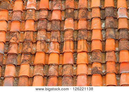 Terracote tiles on the roof, arcitectural background.