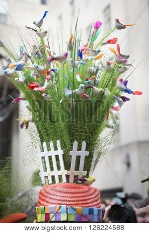 NEW YORK - MAR 27 2016: Close up of a bonnet of grass blades and dozens of little birds worn by a parade goer on 5th Ave Easter Sunday at the traditional Easter Bonnet Parade, New York March 27, 2016.