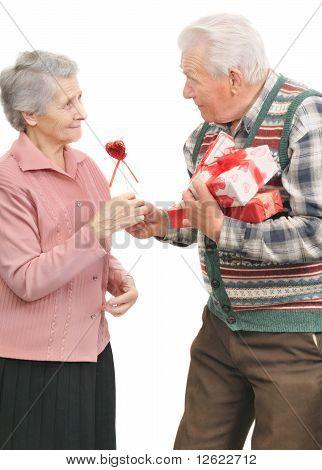 Senior Men Give Gifts To Senior Women