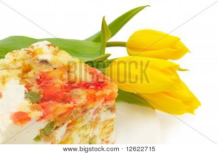 Dessert Fancy Cake And Yellow Tulips