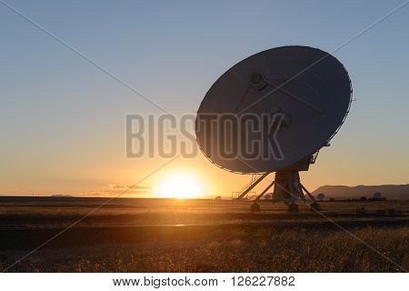 Sunset Huge antenna dish at Very Large Array searching for imaging signal in space