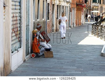 Venice. Italy - June 29, 2012 - The streets of Italy. Street musician in 29 June, 2012 in Venice, Italy