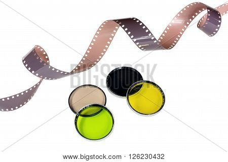 Old camera film and filters isolated on white