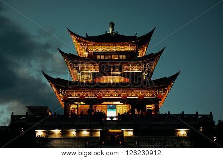 Wuhua House at night as the landmark of Dali Town, Yunnan, China.