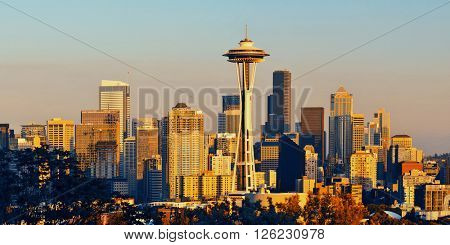 Seattle city skyline at sunset with urban office buildings viewed from Kerry Park.