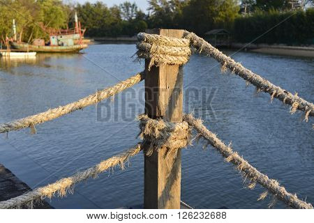 Close up of rope tied with the timber logs, focus on the rope.