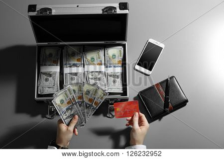 Businesswoman with case full of money
