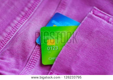 Credit cards in jeans pocket, close up