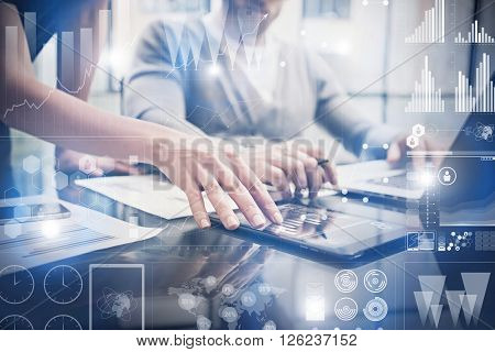 Closeup photo female hands touching screen modern tablet. Bankers team working new investment project in office.Using electronic devices. Graphics icons, stock exchanges interface.