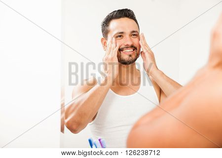 Man Putting On Cream On His Face