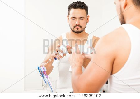 Guy Pouring Shaving Cream On His Hand