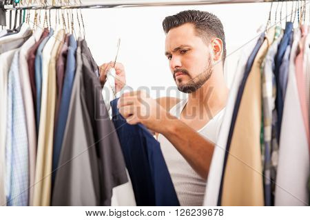 Young Man Deciding What Clothes To Wear