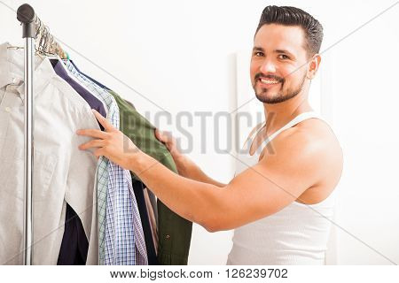 Handsome Man Getting Dressed At Home