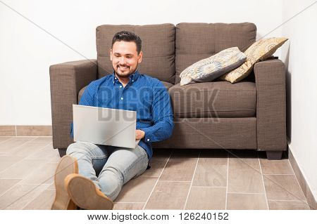 Good Looking Guy Using A Laptop Computer