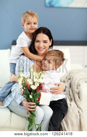 Family concept. Sons greeting mother, close up