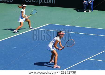 KYIV UKRAINE - APRIL 17 2016: Guadalupe Perez Rojas and Maria Lourdes Carle of Argentina in action during BNP Paribas FedCup World Group II Play-off pair game against Ukraine at Campa Tennis Club