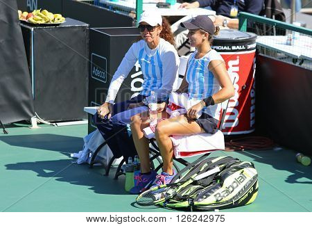KYIV UKRAINE - APRIL 17 2016: Captain of Argentina National Team Maria-Jose Gaidano (L) and player Maria Irigoyen smile during BNP Paribas FedCup game Ukraine vs Argentina at Campa Bucha Tennis Club