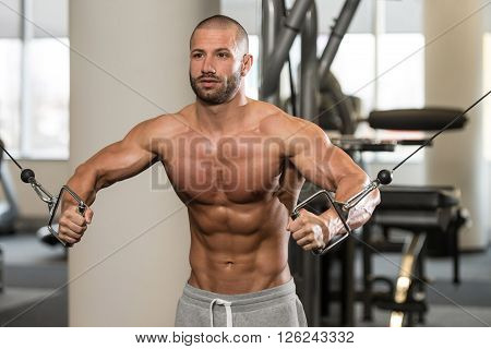 Young Healthy Man Doing Exercise For Chest
