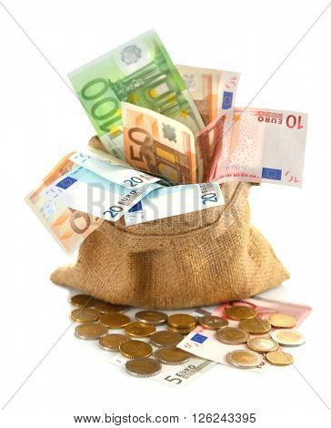 Burlap sack filled with euro banknotes and coins, isolated on white