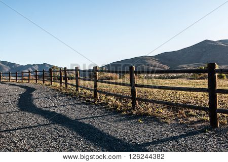 Mountain peak, fence, and pathway in Chula Vista, California.