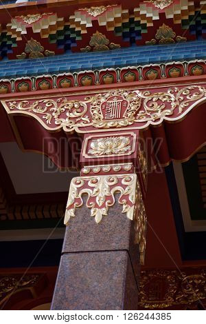 ST. PETERSBURG, RUSSIA - OCTOBER 11, 2015: Decorated columns of Datsan Gunzechoinei. Built in 1915, it is the northernmost Buddhist temple in Russia