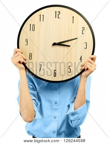Young woman holds a clock, isolated on white