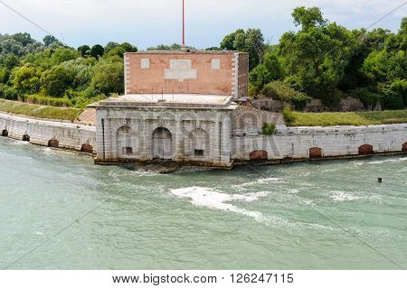 Water gate and bastion of the Sant'Andrea fort at the entrance to Venice's lagoon on the Sant'Andrea island