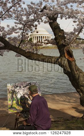 WASHINGTON, DC, USA - MARCH 25: An artist paints the Tidal Basin during the Cherry Blossom Festival on March 25 in Washington, DC