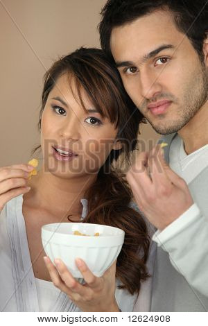 Portrait of a couple with bowl of cereals