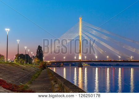 Cable-stayed bridge and embankment of the River Daugava during twilight blue hour, Riga, Latvia