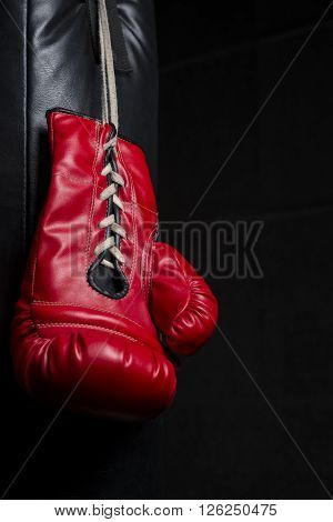 Boxing gloves series : Pair of red boxing gloves inlow key lighting